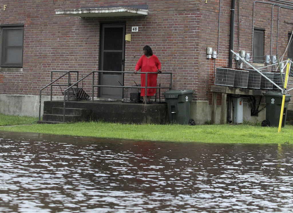 Residents at Trent Court Apartments wait out the weather as rising water gets closer to their doors in New Bern, N.C. Thursday, Sept. 13, 2018. Hurric...
