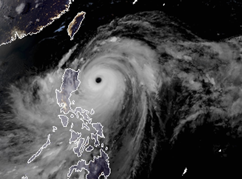 FILE - In this Friday, Sept. 14, 2018, file photo, a satellite image with land graphic borders shows the width and trajectory of Typhoon Mangkhut as i