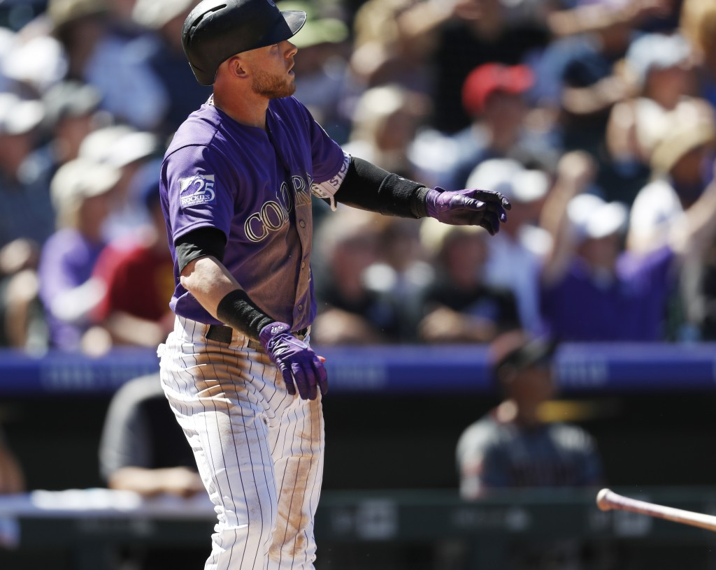 Colorado Rockies' Trevor Story follows the flight of his two-home run off Arizona Diamondbacks starting pitcher Matt Koch in the third inning of a bas