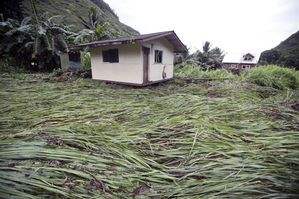 A bedroom building sits atop downed vegetation after being swept up by floodwaters Wednesday, Sept. 12, 2018, in Maui's Honokohau Valley in Hawaii. Ho