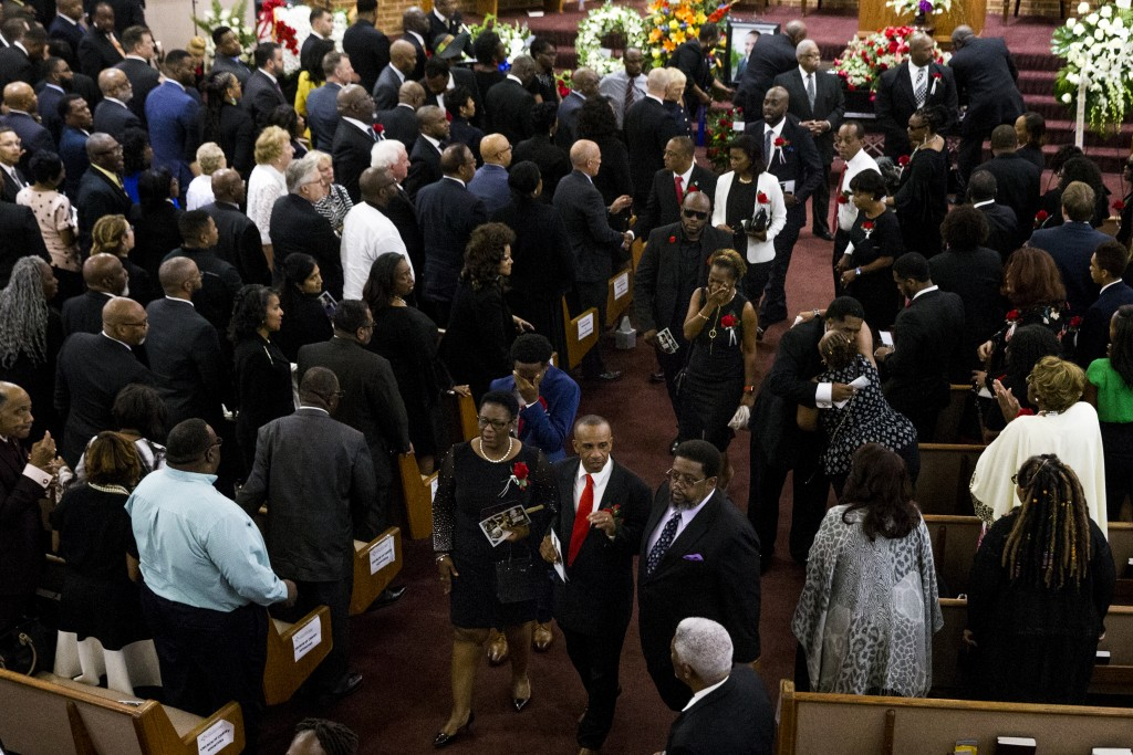 Allison Jean and her husband, Bertram Jean, walk out of the church followed by their son, Brandt Jean, and their daughter, Allisa Findley following a