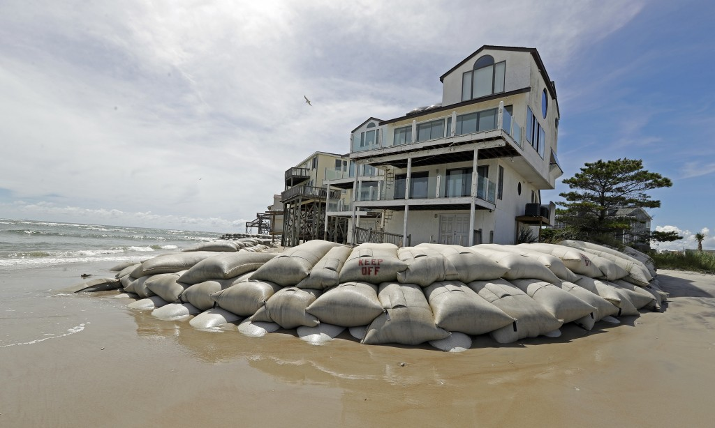 Sand bags surround homes on North Topsail Beach, N.C., Wednesday, Sept. 12, 2018, as Hurricane Florence threatens the coast. (AP Photo/Chuck Burton, F