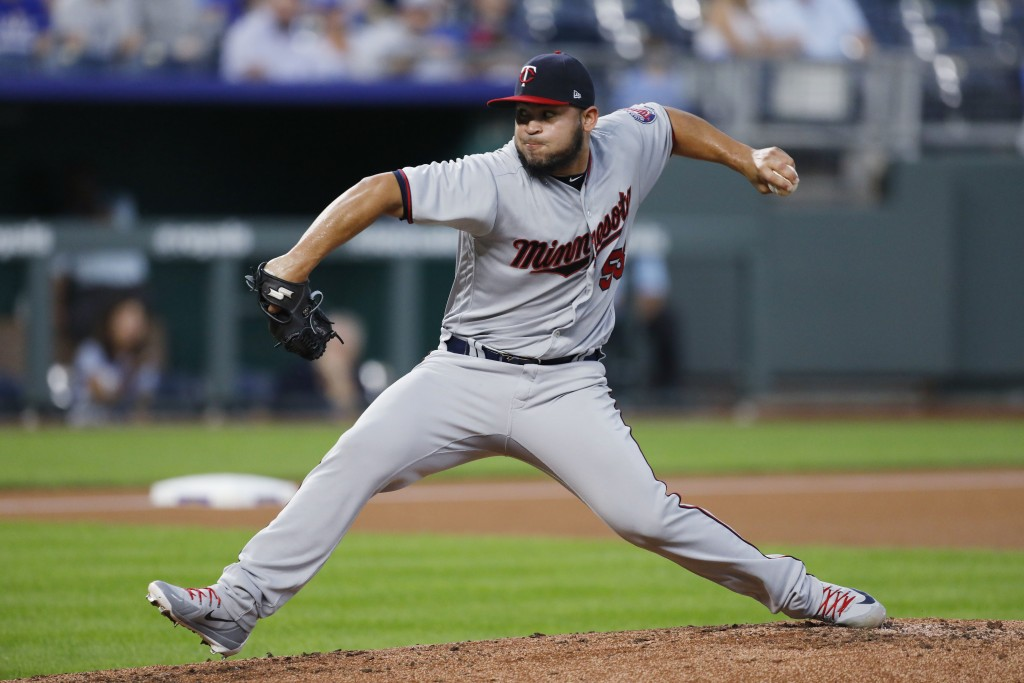 Minnesota Twins pitcher Gabriel Moya throws to a batter in the first inning of a baseball game against the Kansas City Royals at Kauffman Stadium in K