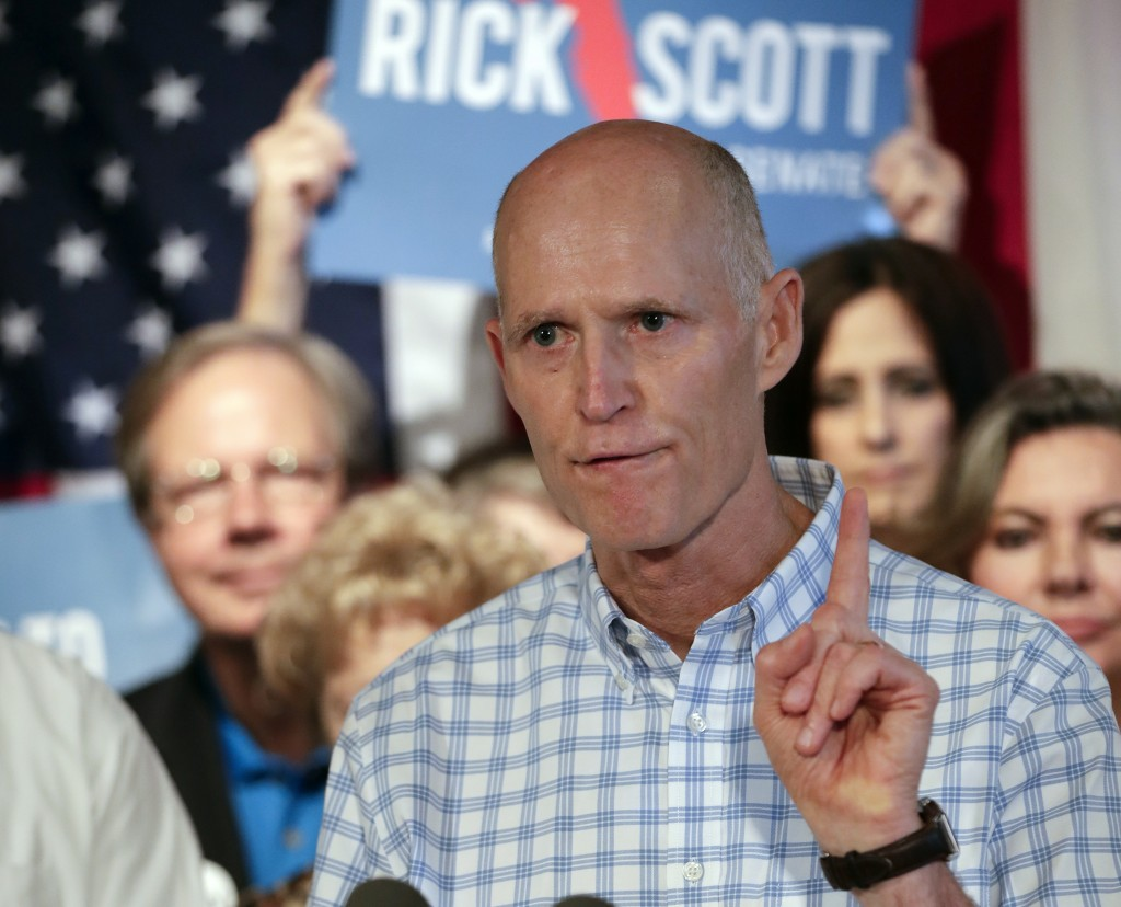FILE - In this Sept. 6, 2018, file photo, Florida Gov. Rick Scott speaks to supporters at Republican rally in Orlando, Fla. Top Florida Republicans in...