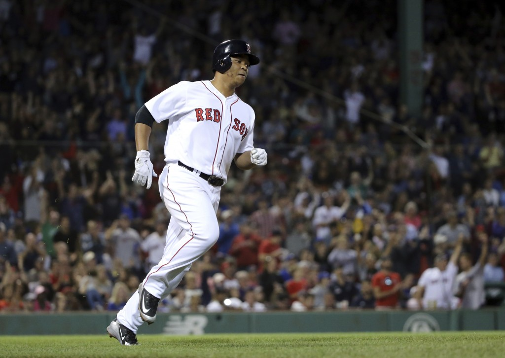 Boston Red Sox's Rafael Devers rounds the bases on a solo home run in the sixth inning of a baseball game against the Toronto Blue Jays at Fenway Park