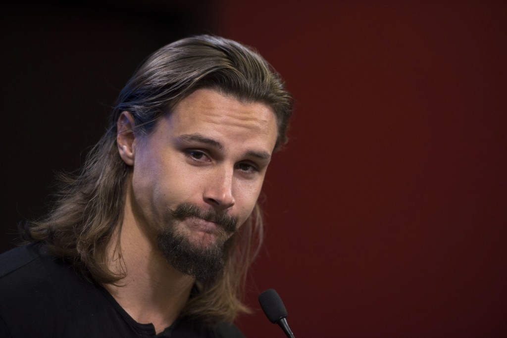 Erik Karlsson, who as traded by the Ottawa Senators to the San Jose Sharks, speaks to media as the Senators reported for the first day of NHL hockey t