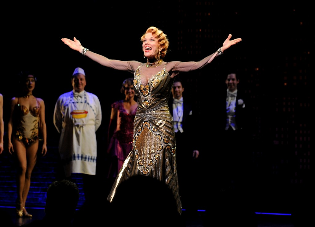 "FILE - In this April 10, 2014 file photo, actor Marin Mazzie on stage during the curtain call for the opening night of ""Bullets Over Broadway"" in New"