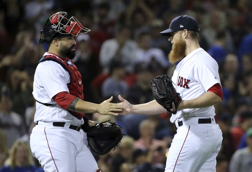 Boston Red Sox closer Craig Kimbrel celebrates with catcher Sandy Leon after they defeated the Toronto Blue Jays in a baseball game at Fenway Park, Th
