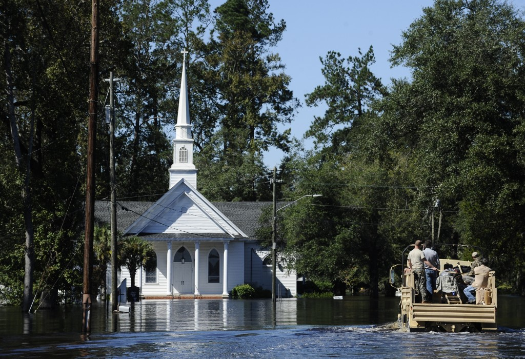 FILE - In this Tuesday, Oct. 11, 2016 photo, Nichols Methodist Church is seen under floodwaters, in Nichols, S.C. Few places in South Carolina are mor