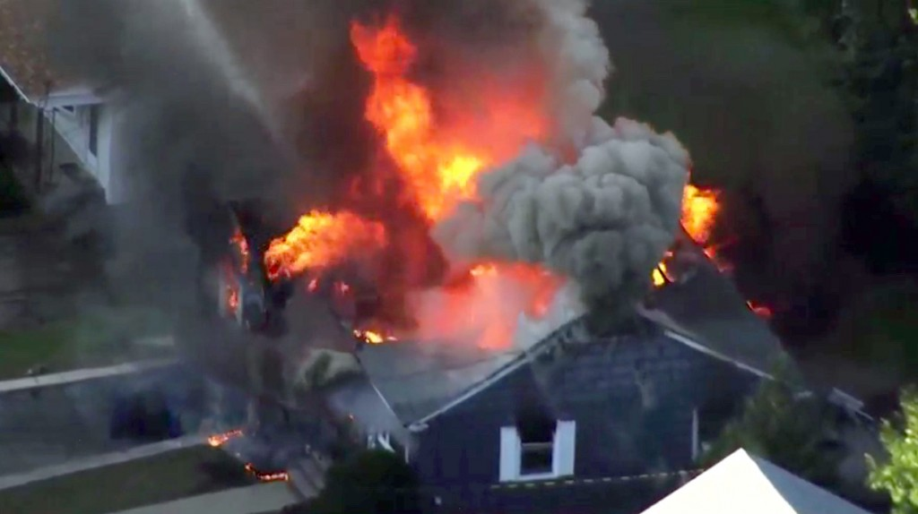 In this image take from video provided by WCVB in Boston, flames consume a home in Lawrence, Mass, a suburb of Boston, Thursday, Sept. 13, 2018. Emerg
