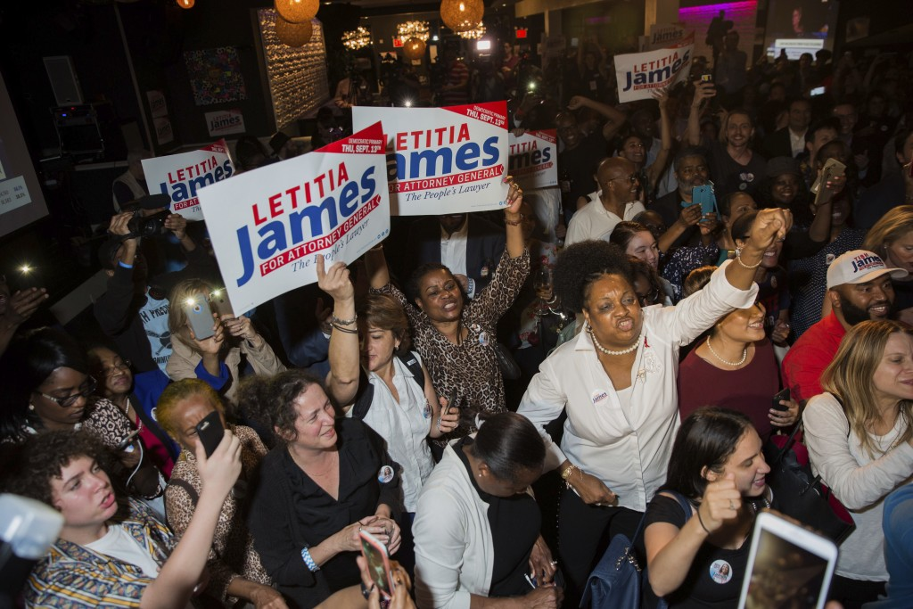 Supporters celebrate after the Democratic primary for attorney general was called in favor of Letitia James Thursday, Sept. 13, 2018, in New York. The