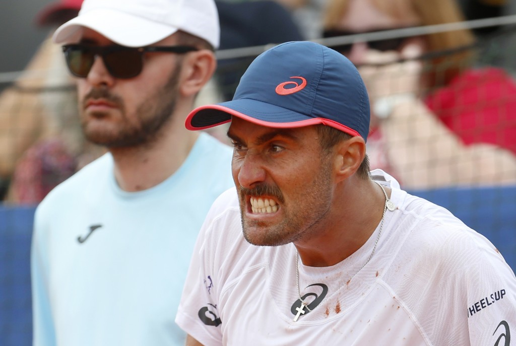Steve Johnson of the United States pulls a face as he reacts to a line call as he plays against Borna Coric of Croatia during a Davis Cup semifinal si