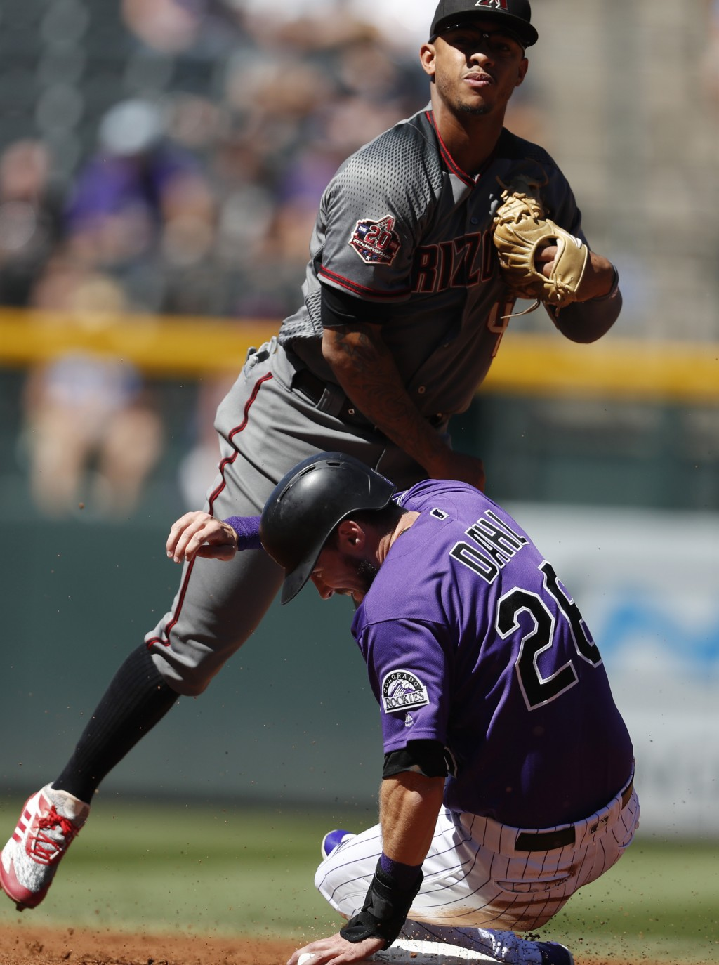 Arizona Diamondbacks shortstop Ketel Marte throws over Colorado Rockies' David Dahl after forcing him out at second base on the front end of a double