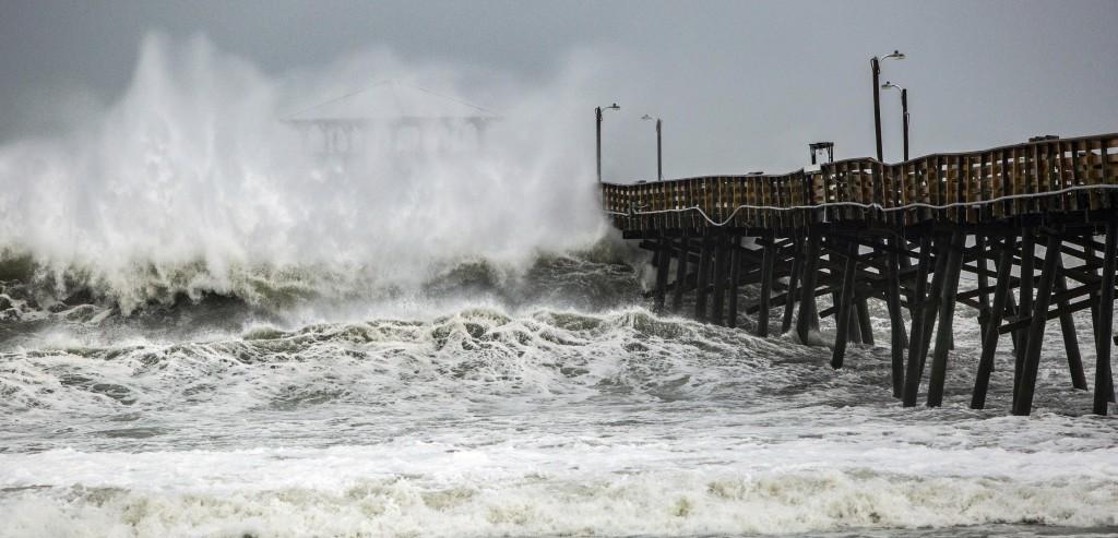 Waves slam the Oceana Pier & Pier House Restaurant in Atlantic Beach, N.C.,  Thursday, Sept. 13, 2018 as Hurricane Florence approaches the area.  (Tra