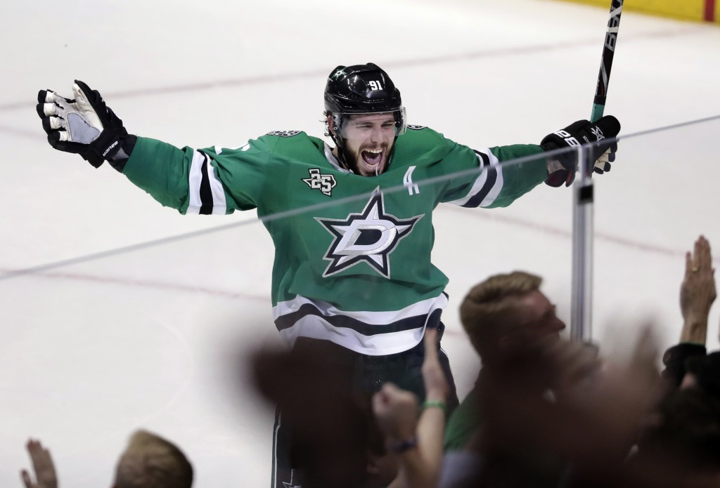 FILE - In this March 3, 2018, file photo, Dallas Stars' Tyler Seguin (91) celebrates their 3-2 overtime win in an NHL hockey game against the St. Loui