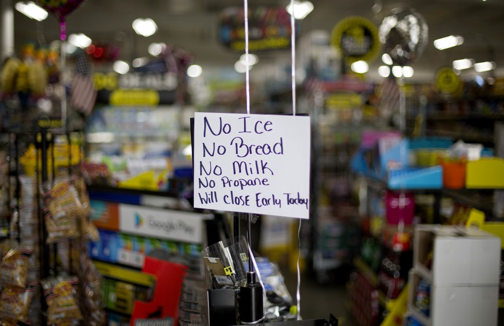 A message greets shoppers of supplies no longer available as Hurricane Florence approaches the east coast in Nichols, S.C., Thursday, Sept. 13, 2018.