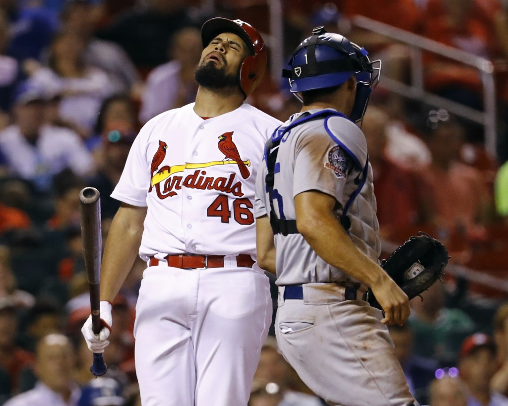 St. Louis Cardinals' Francisco Pena, left, reacts after being called out on strikes, as Los Angeles Dodgers catcher Austin Barnes looks on during the