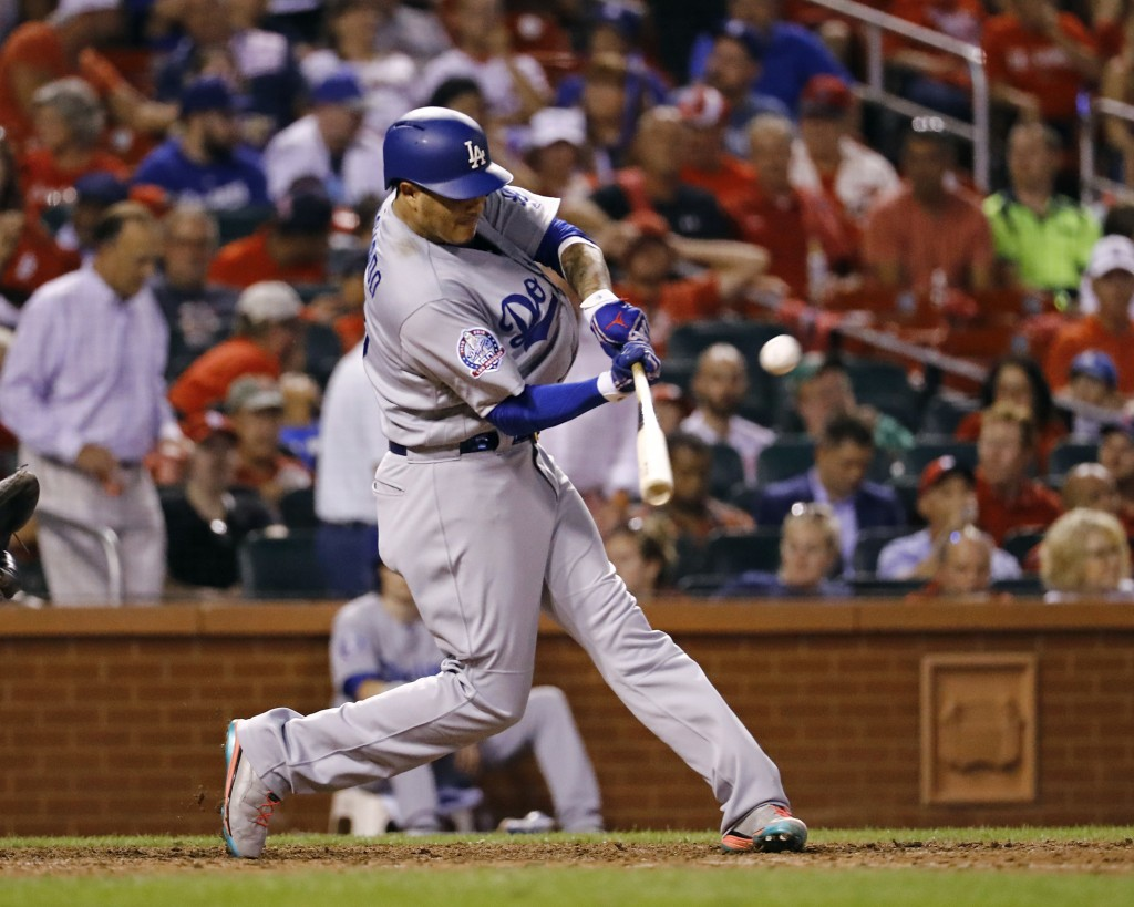 Los Angeles Dodgers' Manny Machado hits a home run off off St. Louis Cardinals relief pitcher John Brebbia during the seventh inning of a baseball gam