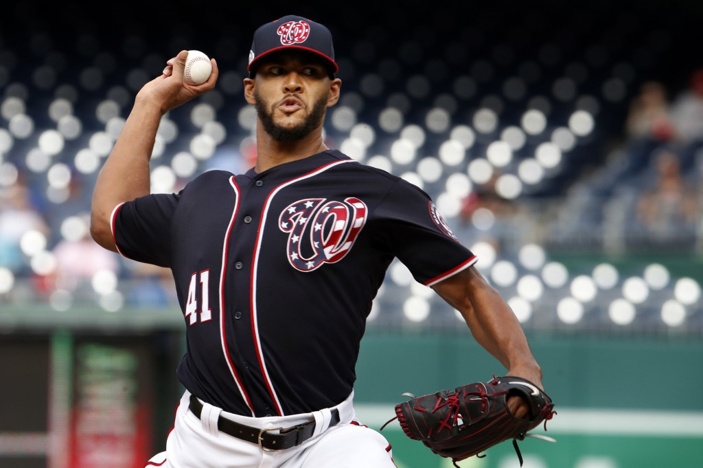Washington Nationals starting pitcher Joe Ross delivers the ball during the first inning of a baseball game against the Chicago Cubs, Thursday, Sept.