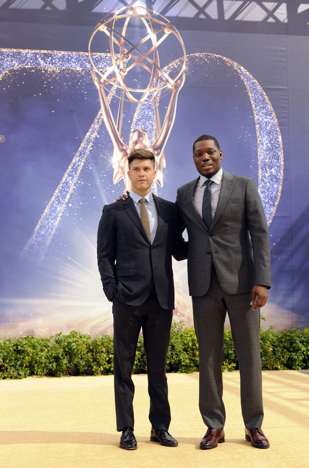 Colin Jost, left, and Michael Che, co-hosts for the 70th Emmy Awards, pose after rolling out the gold carpet outside the Microsoft Theatre, Thursday,