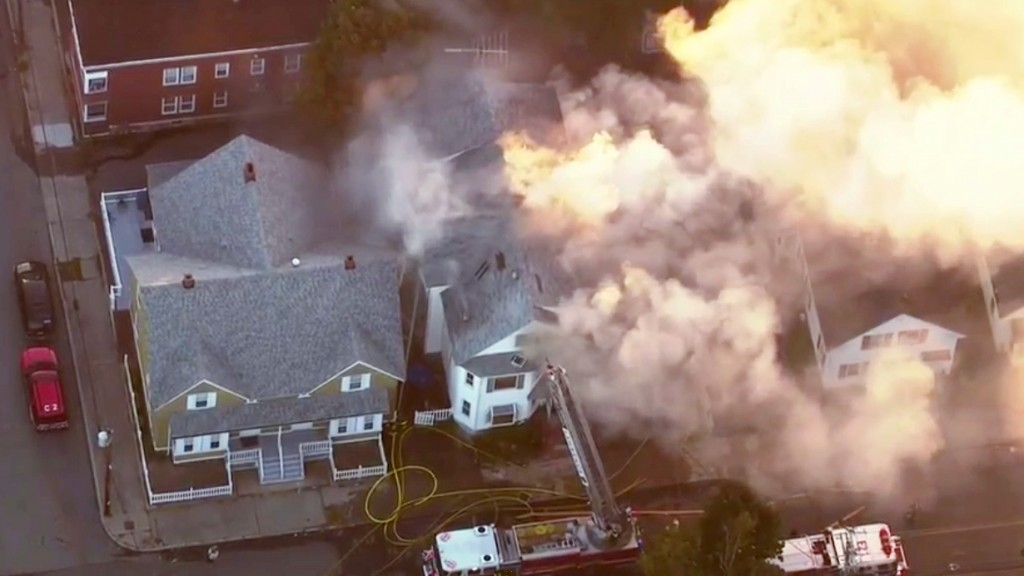 In this image take from video provided by WCVB in Boston, firefighters battle a large structure fire in Lawrence, Mass, a suburb of Boston, Thursday,
