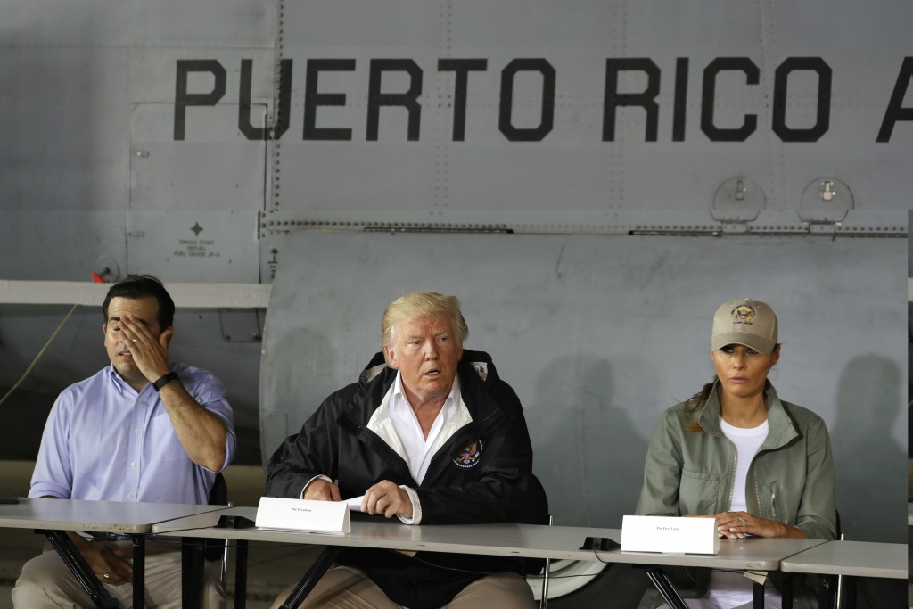 FILE - In this Oct. 3, 2017, file photo, President Donald Trump talks about recovery efforts after he and first lady Melania Trump arrived at Luis Mun