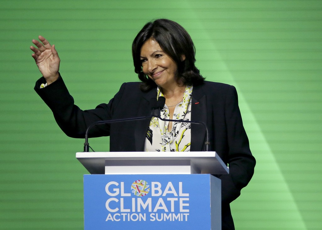 Mayor of Paris Anne Hidalgo waves after speaking during the opening plenary of the Global Action Climate Summit Thursday, Sept. 13, 2018, in San Franc