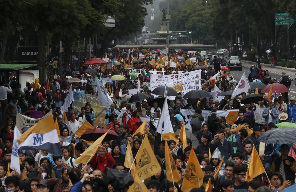 Thousands of students march in protest against groups of institutional thugs that operate on campus at Mexico's National Autonomous University, UNAM,