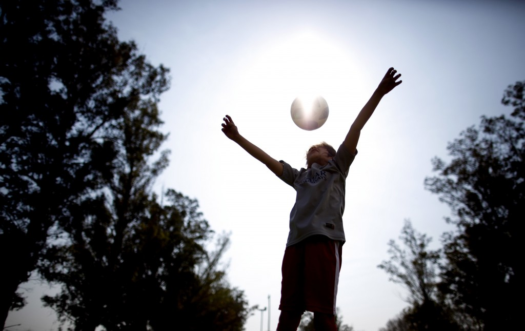 """In this Sept. 8, 2018 photo, Candelaria Cabrera plays with a soccer ball in Chabas, Argentina. """"Cande,"""" as she is known by friends and family, is the"""