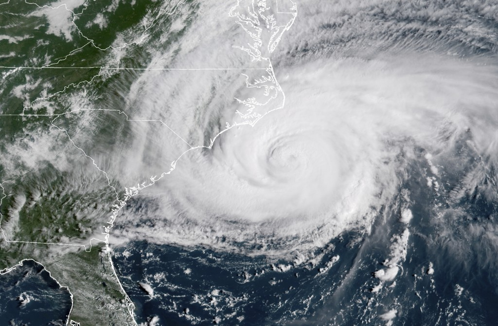 This satellite image provided by NOAA shows Hurricane Florence on the eastern coast of the United States on Friday, Sept. 14, 2018. (NOAA via AP)