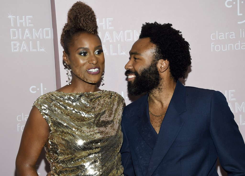 Actress Issa Rae, left, and actor/rapper Donald Glover attend the 4th annual Diamond Ball at Cipriani Wall Street on Thursday, Sept. 13, 2018, in New ...