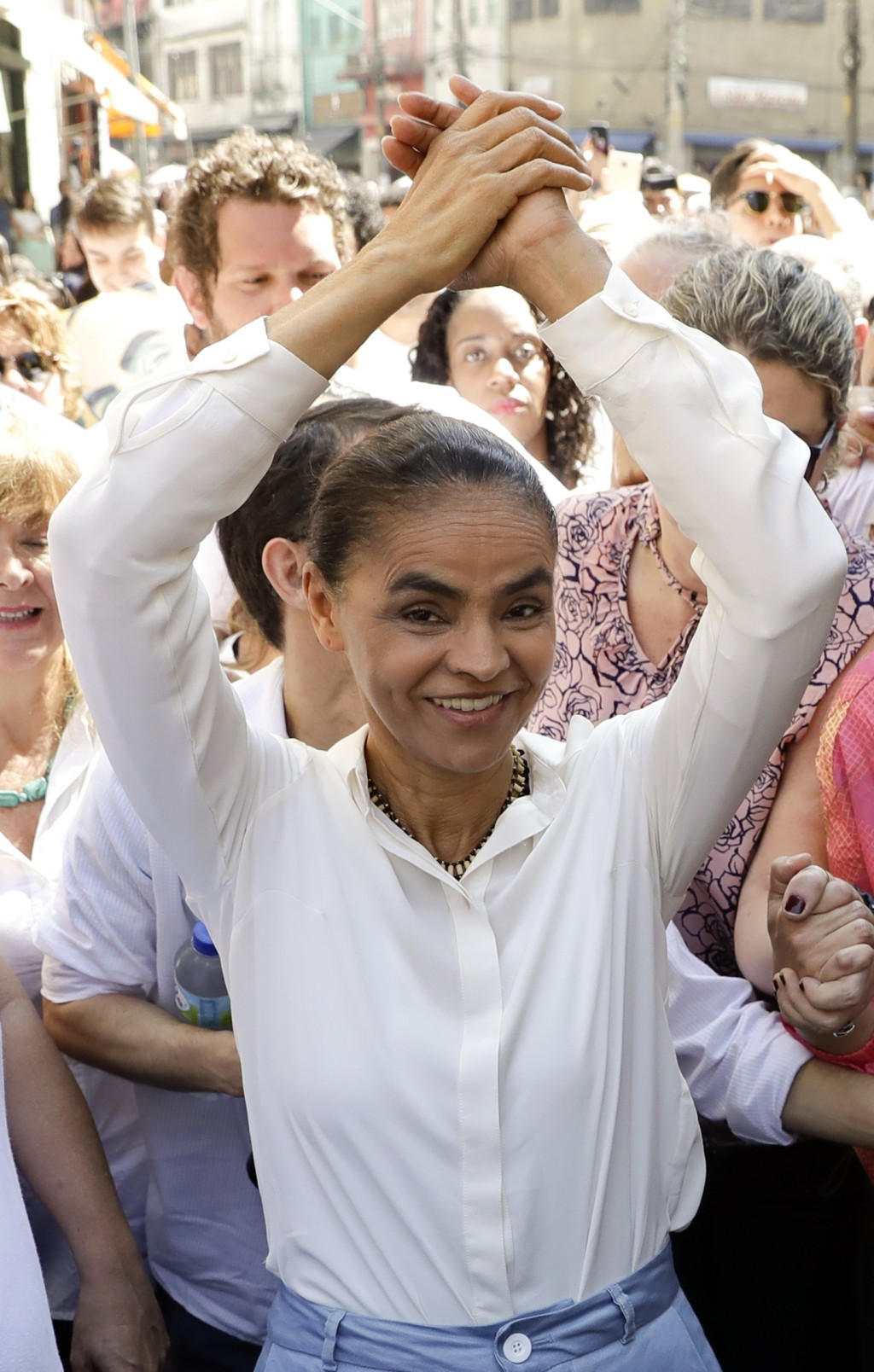 FILE - In this Sept. 8, 2018 file photo, Brazilian presidential candidate Marina Silva strikes a winner's pose as she campaigns in downtown Sao Paulo,