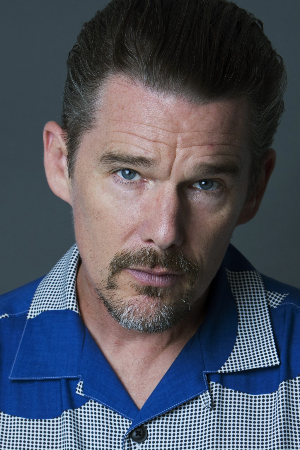 "In this Sept. 6, 2018 photo, actor-director Ethan Hawke poses for a portrait in New York to promote his film ""Blaze."" (Photo by Amy Sussman/Invision/A"