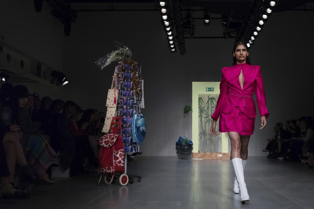 A model wears a creation by designer Richard Malone during the Spring/Summer 2019 runway show at London Fashion Week in London, Friday, Sept. 14, 2018