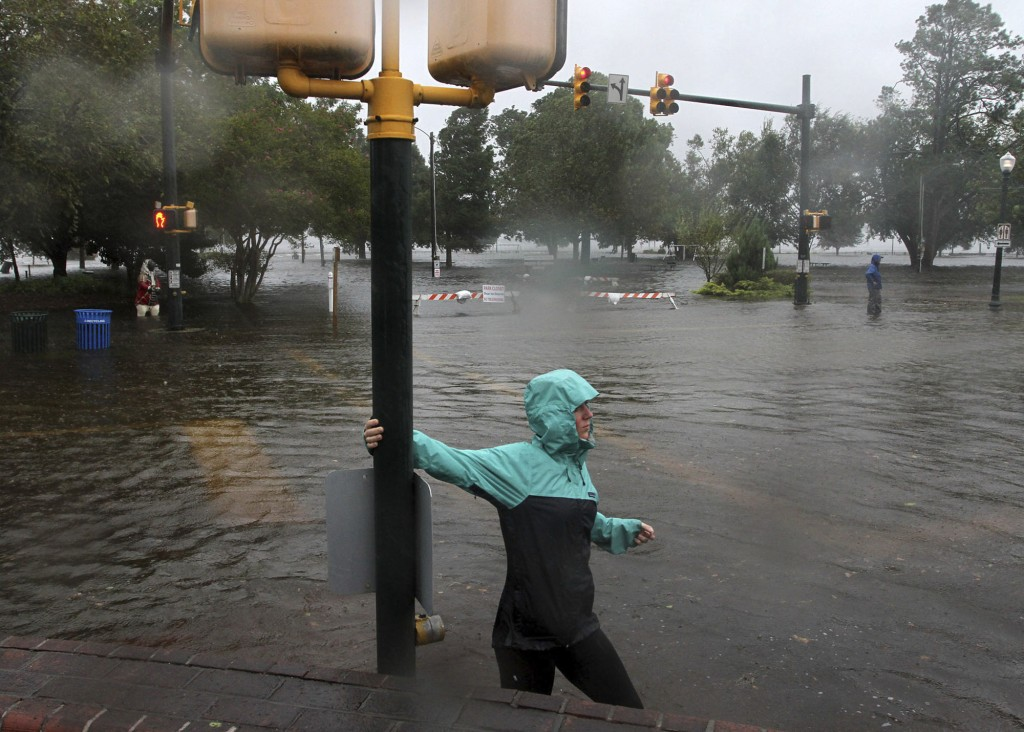 Jamie Thompson walks through flooded sections of East Front Street near Union Point Park in New Bern, N.C. Thursday, Sept. 13, 2018. Hurricane Florenc