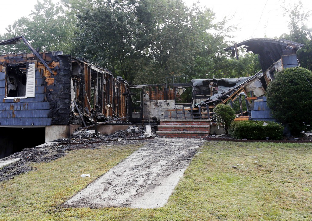 ADDS NAME OF THE POLICE OFFICER HOMEOWNER - The house owned by Lawrence Police Officer Ivan Soto sits nearly burned to the ground on Jefferson Street,