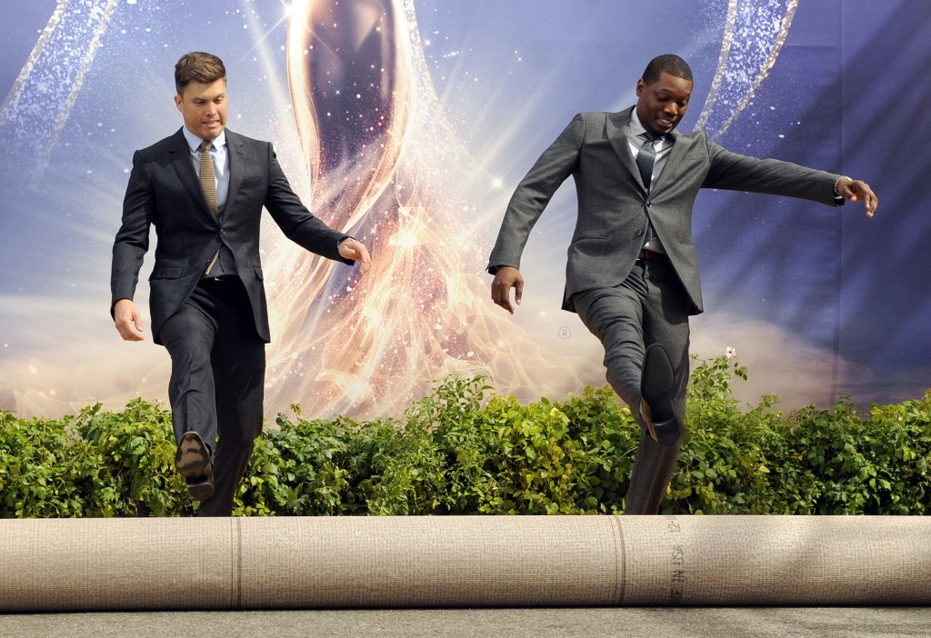 Colin Jost, left, and Michael Che, co-hosts for the 70th Emmy Awards, roll out the gold carpet outside the Microsoft Theatre, Thursday, Sept. 13, 2018