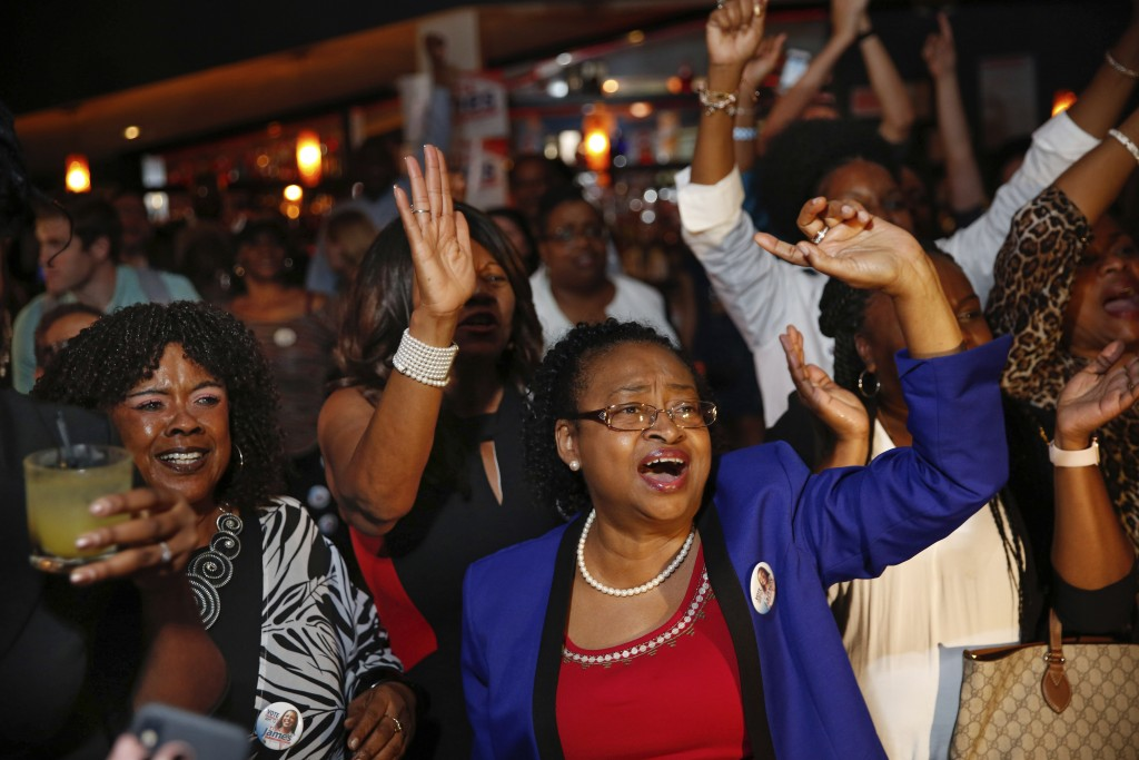 Supporters celebrate after the Democratic primary for attorney general was called in favor of Letitia James Thursday, Sept. 13, 2018, in New York. (AP