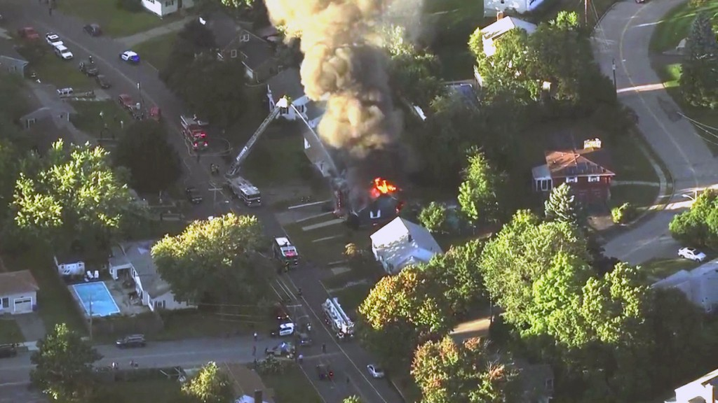 In this image take from video provided by WCVB in Boston, firefighters battle a raging house fire in Lawrence, Mass, a suburb of Boston, Thursday, Sep