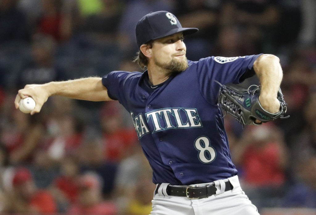 Seattle Mariners starting pitcher Mike Leake throws against the Los Angeles Angels during the first inning of a baseball game in Anaheim, Calif., Thur