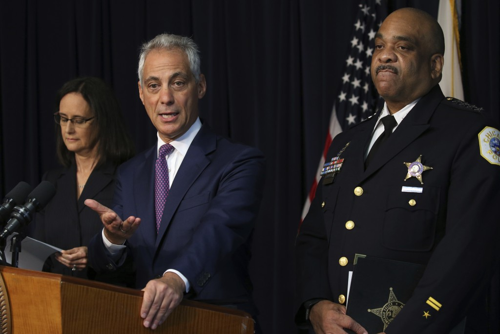 Chicago mayor Rahm Emanuel flanked by Chicago police Superintendent Eddie Johnson and Attorney General Lisa Madigan, announce that they have filed a p