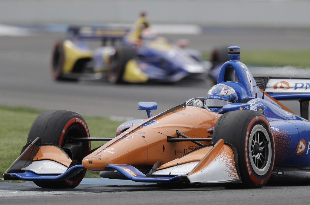 FILE - In this  May 12, 2018, file photo, Scott Dixon, of New Zealand, heads through a turn during the IndyCar Grand Prix auto race at Indianapolis Mo