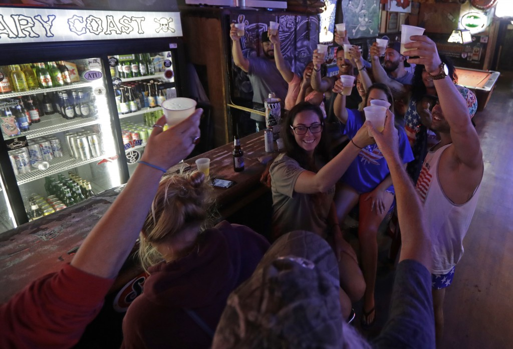 Locals riding out the storm toast Hurricane Florence as they relax at the Barbary Coast bar in downtown Wilmington, N.C., as the Florence threatens th