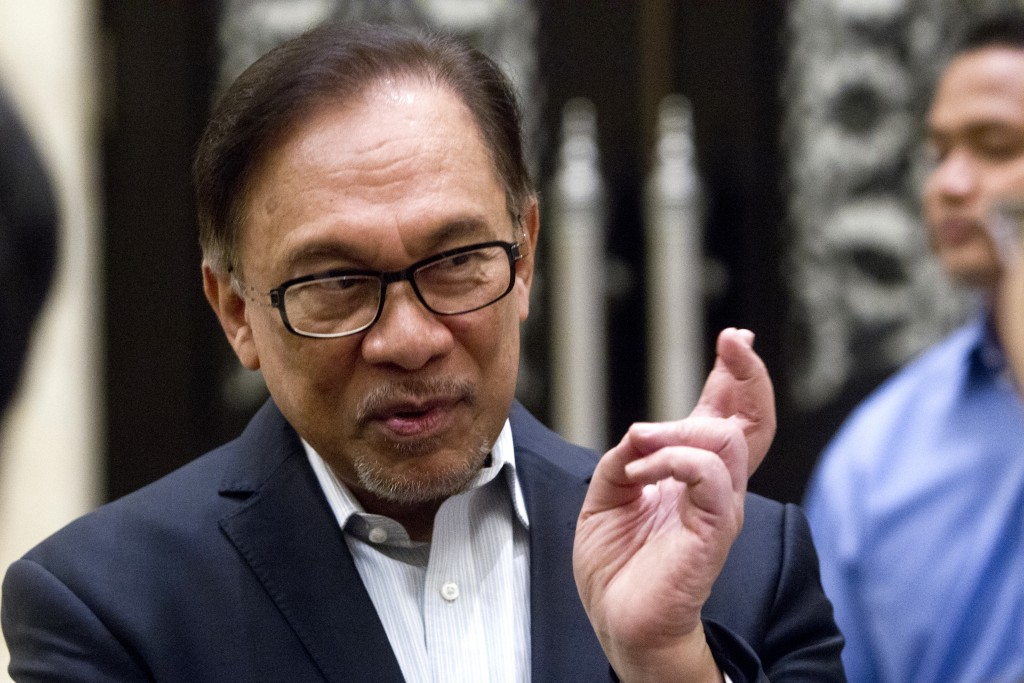 Malaysian politician Anwar Ibrahim speaks before a court hearing at Federal Court in Putrajaya, Malaysia, Friday, Sept. 14, 2018. Anwar, who is named