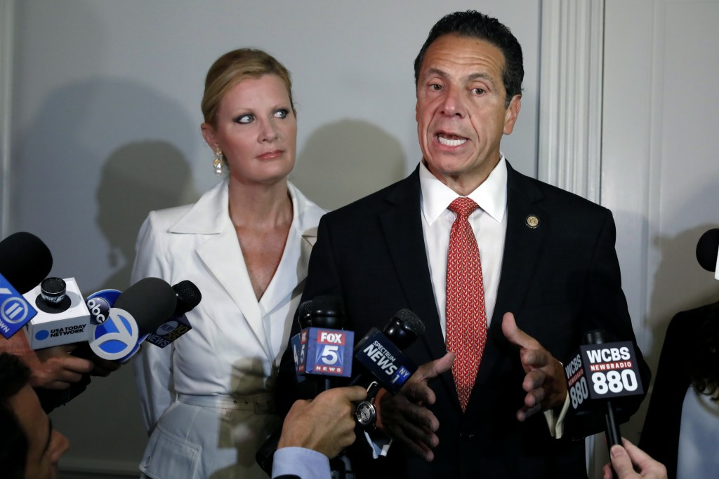 New York Gov. Andrew Cuomo is accompanied by his girlfriend Sandra Lee as he talks to the press after casting his primary election ballot, at the Pres