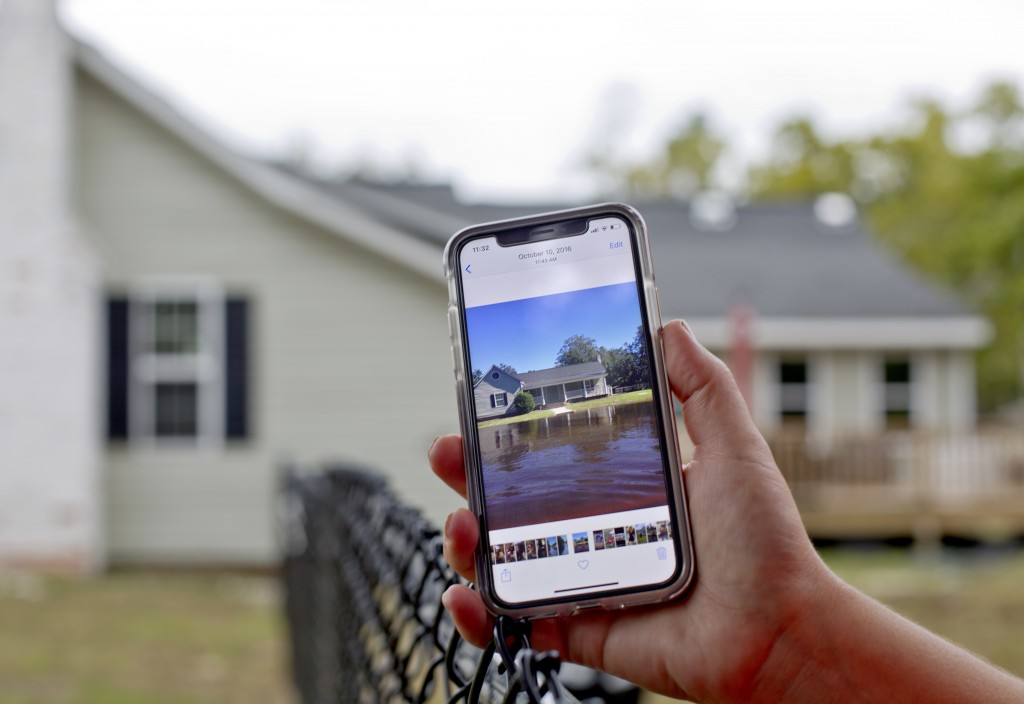 "Jodi Pajaro shows an image of the water which surrounded her home from Hurricane Matthew two years ago in Nichols, S.C., Thursday, Sept. 13, 2018. ""Fl"