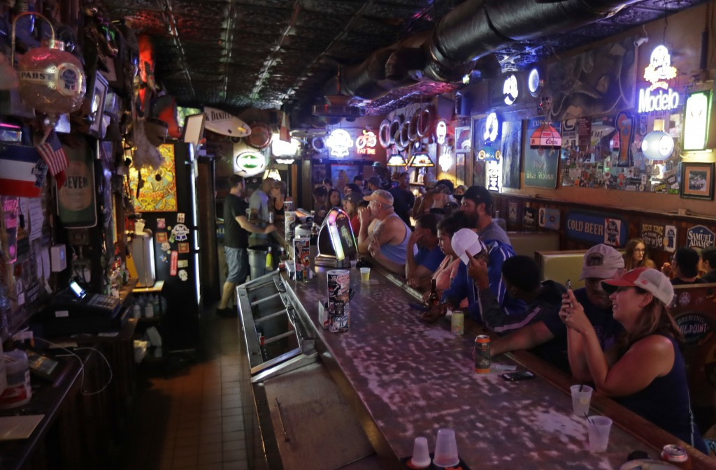 Locals have a drink as they relax at the Barbary Coast bar in downtown Wilmington, N.C., as  Florence threatens the coast Thursday, Sept. 13, 2018. (A