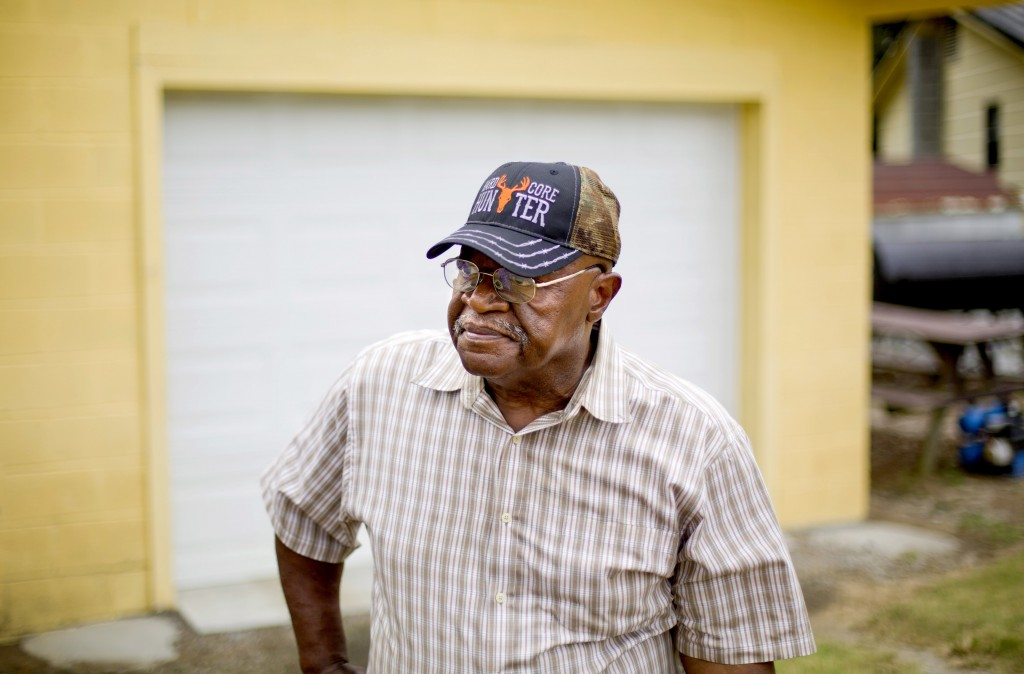 """Thomas Lee stands outside his home which flooded two years ago from Hurricane Matthew in Nichols, S.C., Thursday, Sept. 13, 2018. """"If it floods like t"""