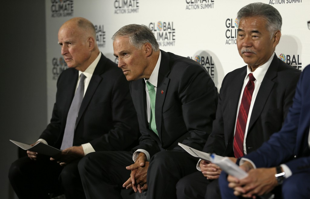 From left, California Gov. Jerry Brown, Washington Gov. Jay Inslee and Hawaii Gov. David Ige listen to questions during a news conference at the Globa...