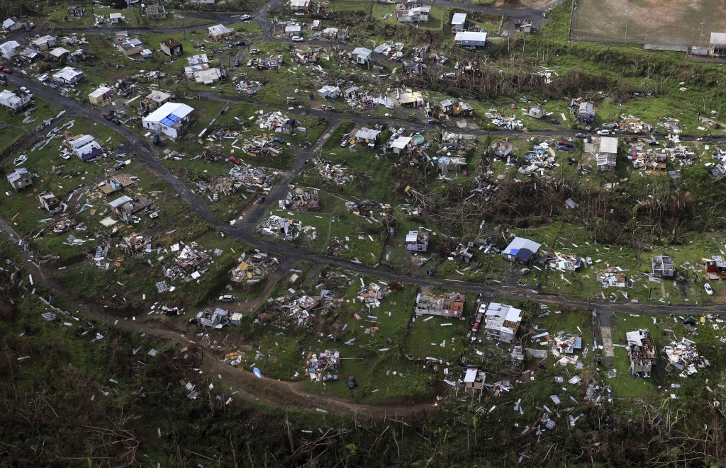 FILE - In this Sept. 28, 2017, file photo, homes and other buildings destroyed by Hurricane Maria lie in ruins in Toa Alta, Puerto Rico. Top Florida R...
